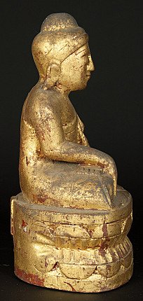 Old gilded Buddha statue