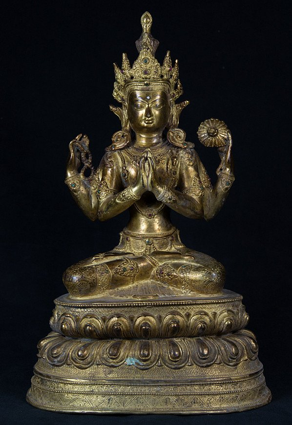 Old copper Avalokiteshvara statue