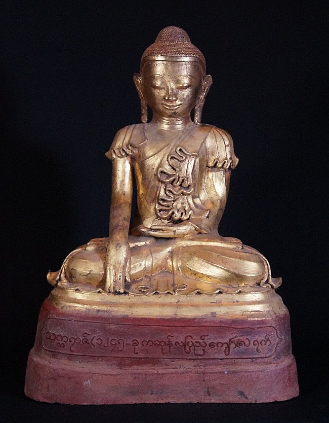 Old lacquer Burmese Buddha statue