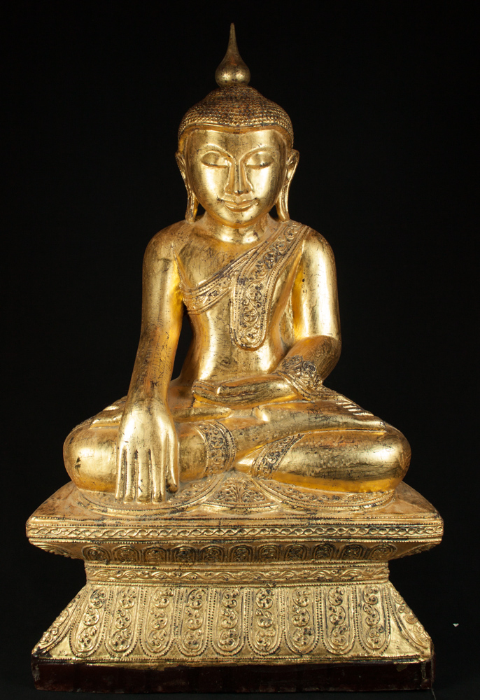 Old teakwooden Buddha statue from Burma