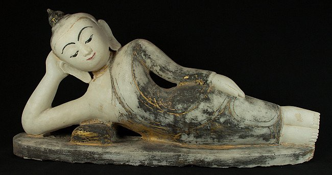 Old marble reclining Buddha statue