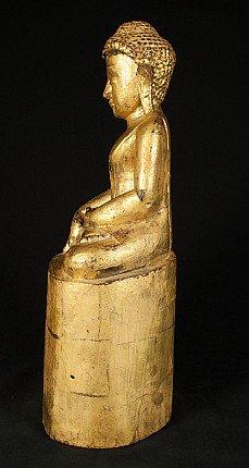 Old wooden Burmese Buddha statue