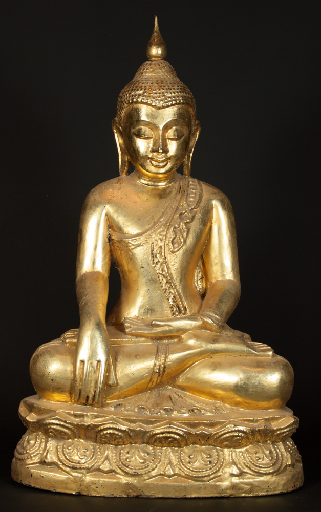 Old teakwooden Buddha statue from Burma made from Wood