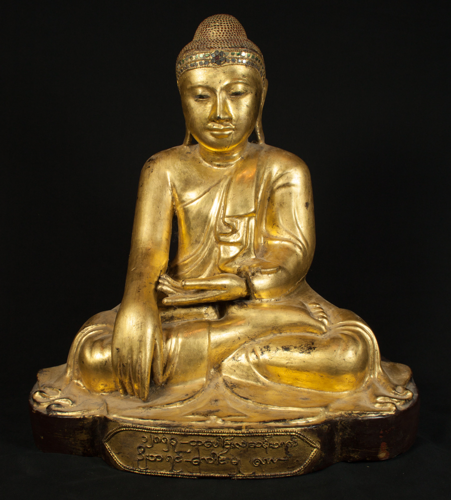 Antique wooden Buddha statue from Burma