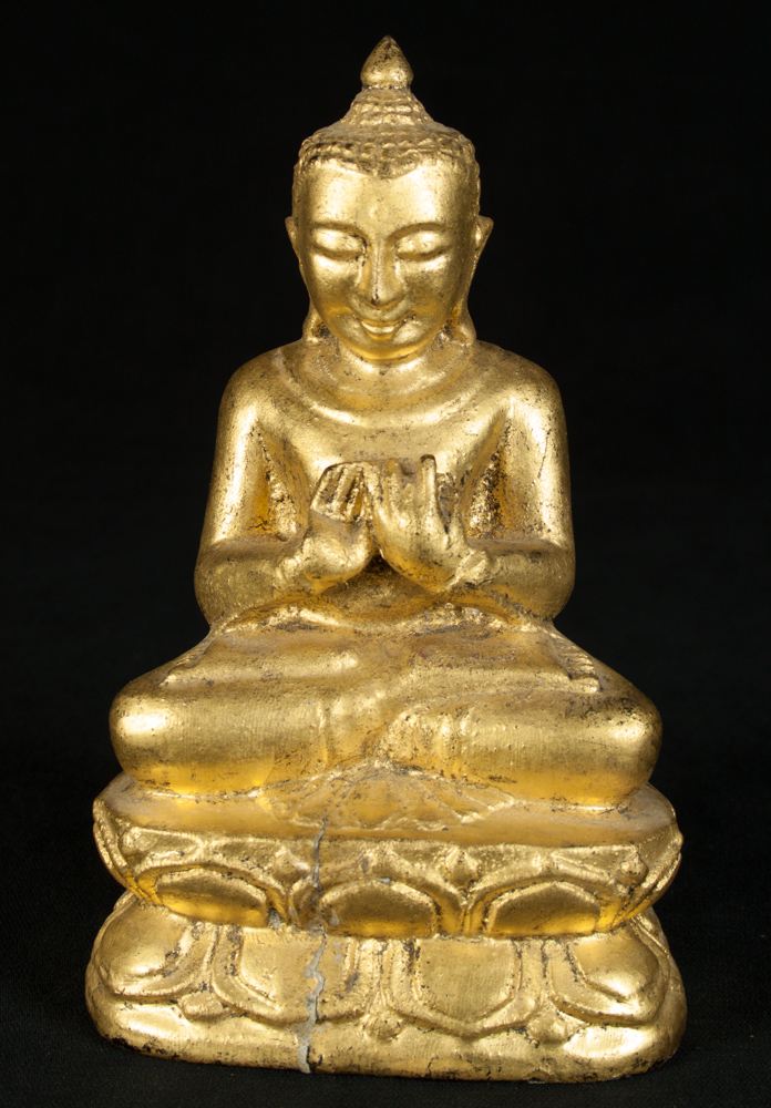 Old wooden Buddha statue from Burma