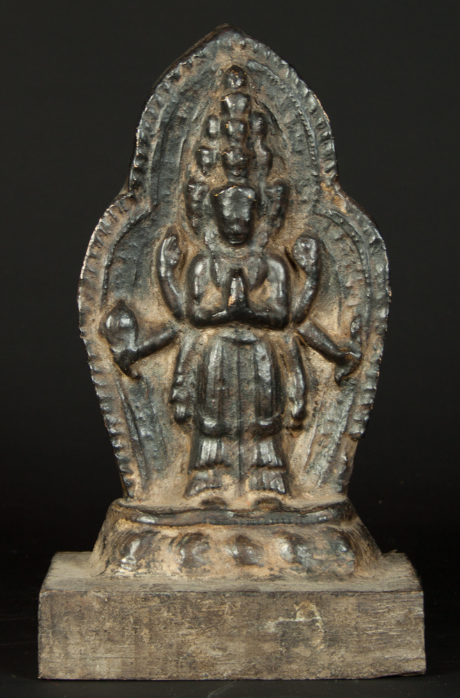 Standing Avaloketishvara statue from Nepal made from Earthenware and wood