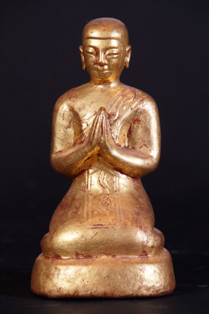 Old Burmese monk statue from Burma made from Wood