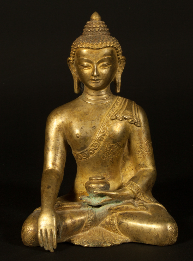 Old copper Buddha statue from Nepal