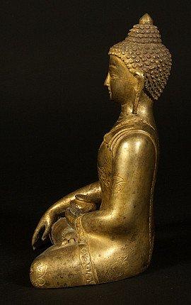 Old copper Buddha statue