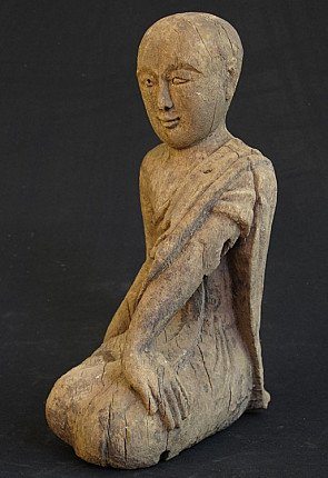 Antique monk statue