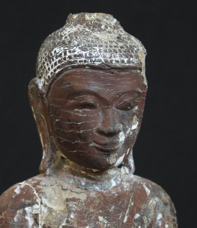 Antique sitting Buddha from Burma made from lacquer