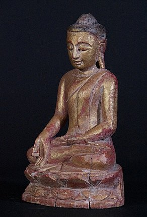 Old wooden Buddha statue