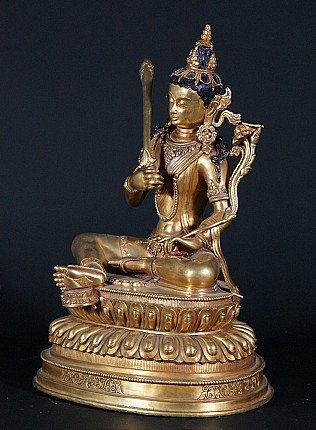 Old copper Manjushree statue