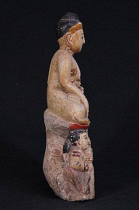 Antiek kalkstenen Boeddhabeeld