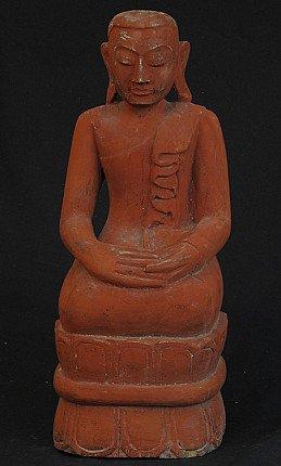 Old kneeling monk