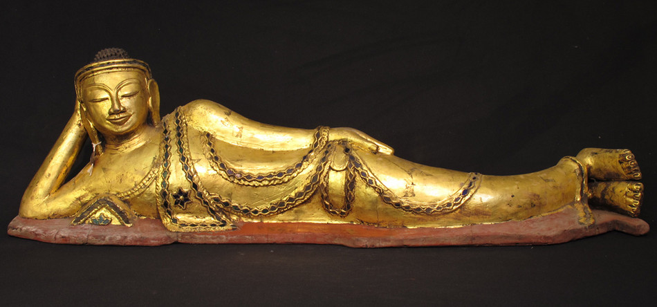 Antique reclining Buddha from Burma made from lacquer