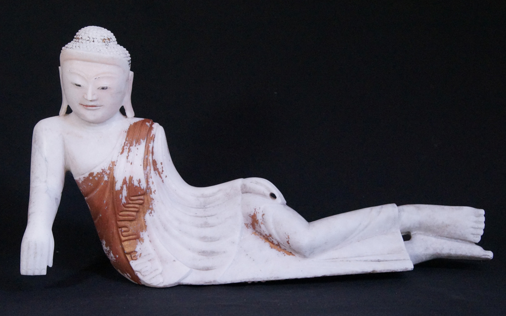 Antique reclining Buddha statue from Burma