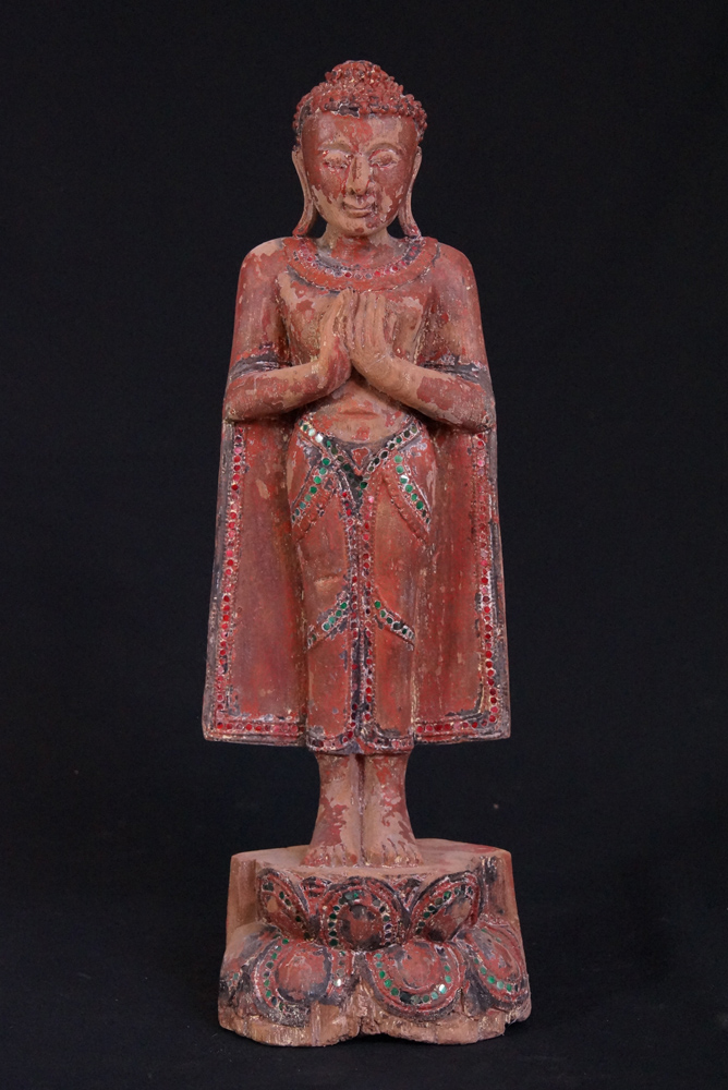 Old standing Buddha statue from Burma