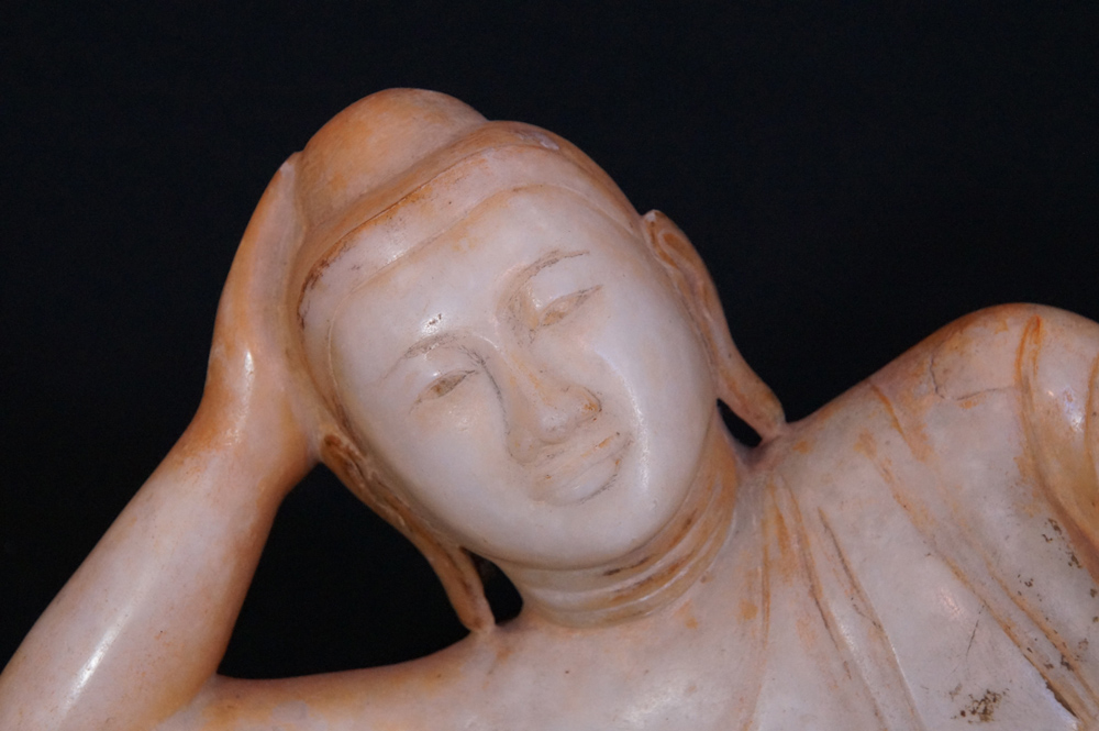 Antique reclining Buddha statue from Burma made from Marble