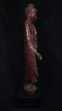 Large standing wooden Buddha statue