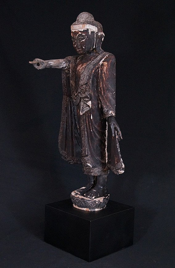 Antique standing Mandalay Buddha statue