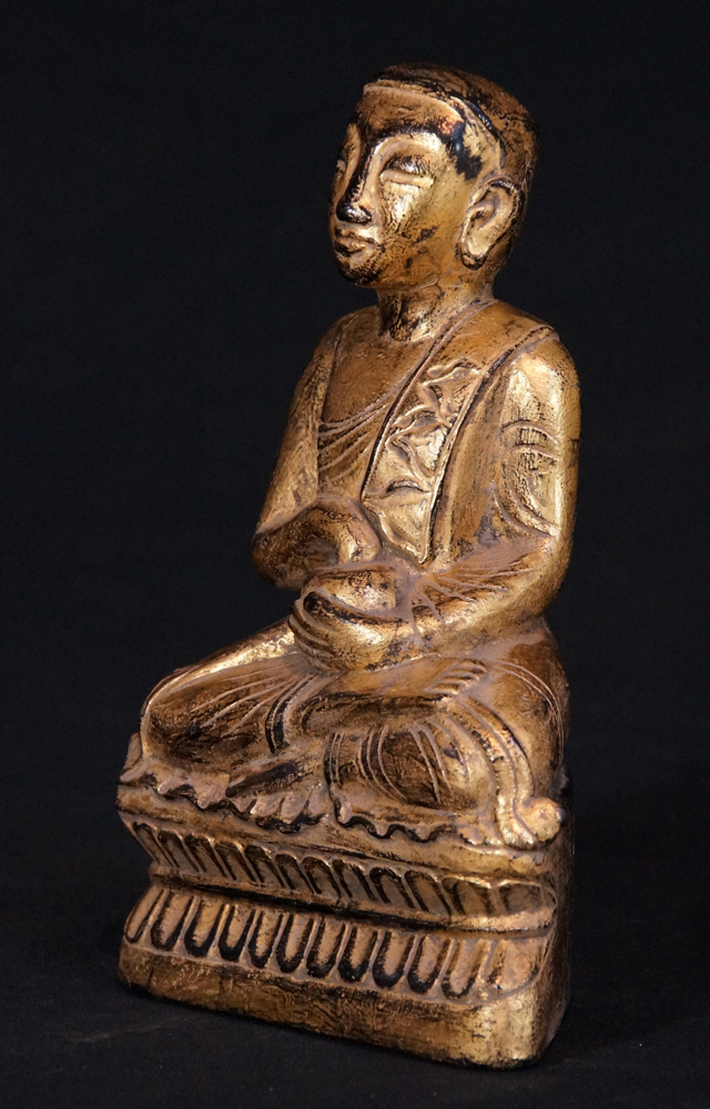 Antique wooden monk statue from Burma