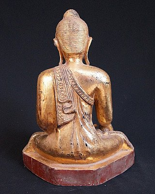 Old wooden Mandalay Buddha