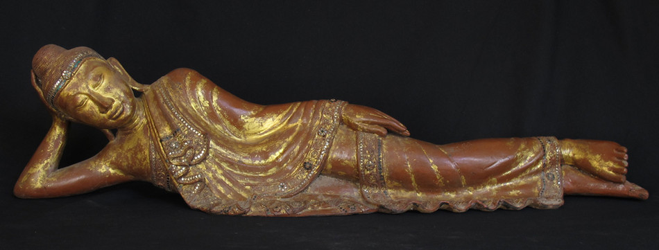 Antique reclining Buddha from Burma made from Wood