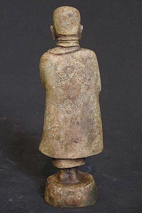 Old bronze monk statue