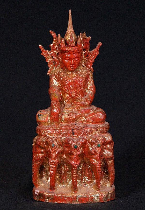 Oude houten Kroonboeddha