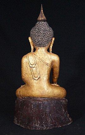 Old lacquerware Buddha statue