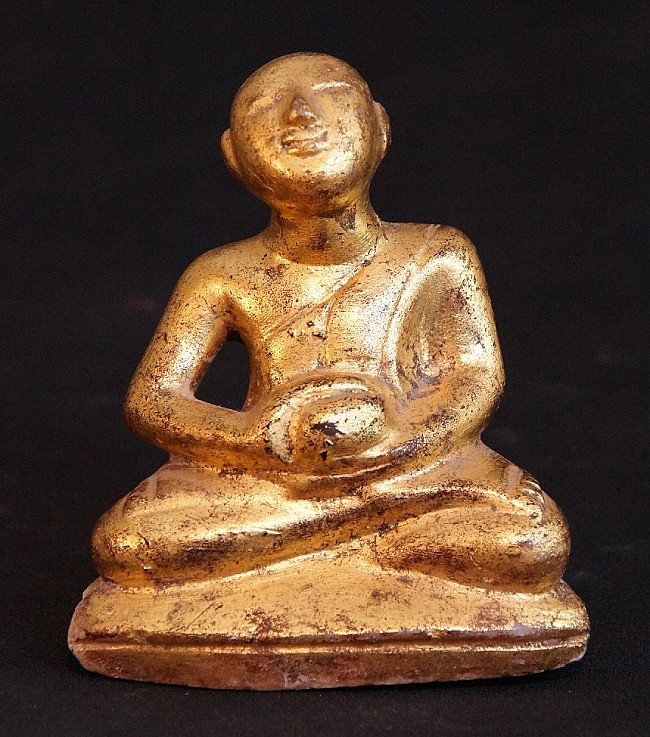 Old marble monk statue