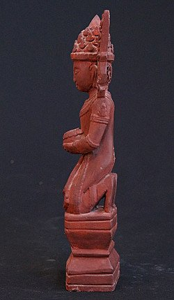 Old crowned Monk statue