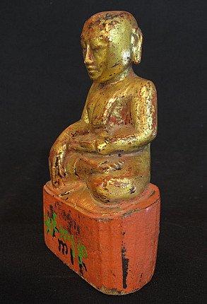 Antique monk sculpture
