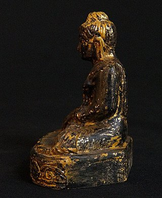 Old wooden Mandalay Buddha
