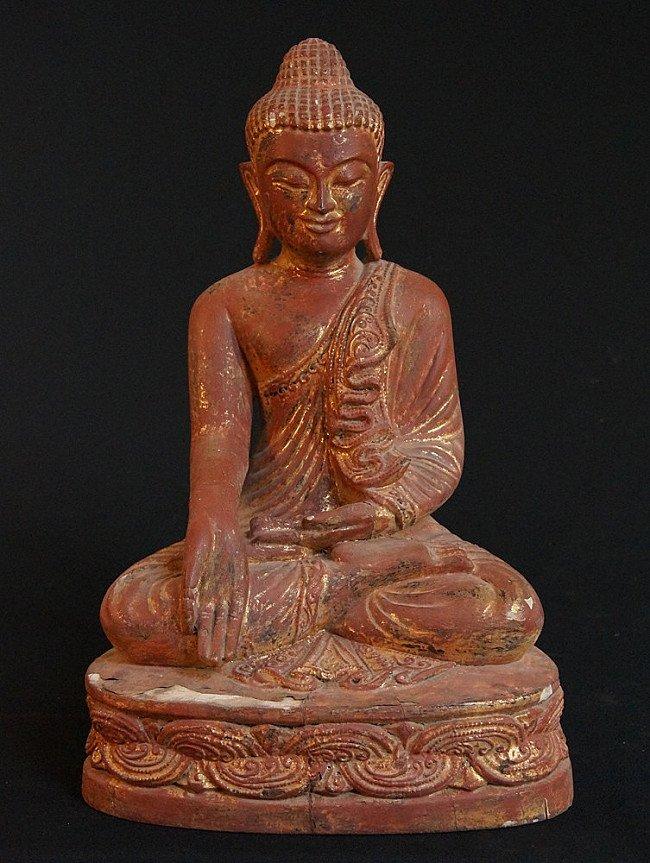 Old wooden Buddha image