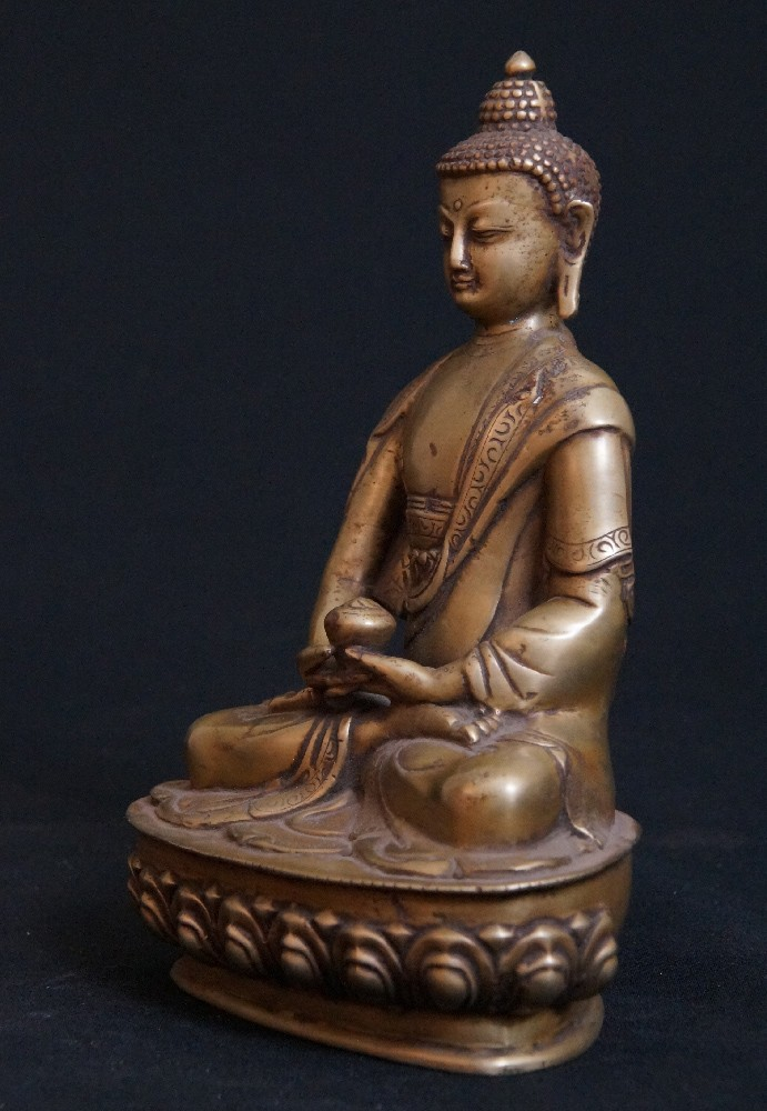 old indian buddha from india made from bronze