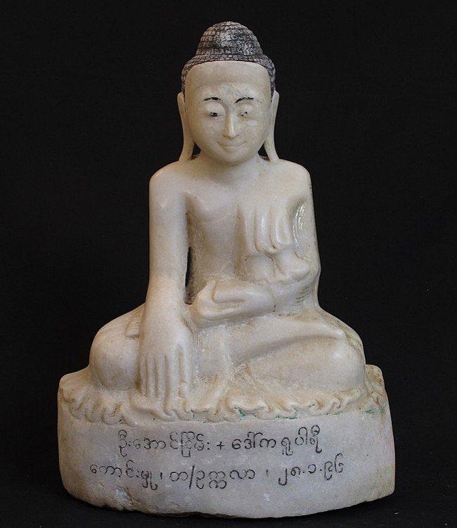 Antique marble stone Buddha