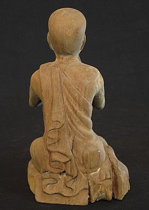 Antique monk statue