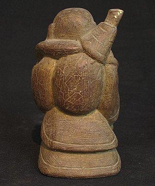 Old Happy Buddha statue