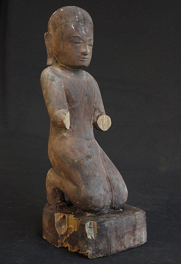 Antique kneeling monk