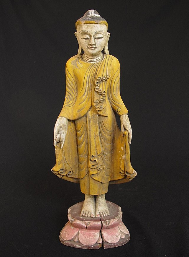 Old standing wooden Buddha