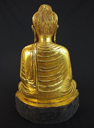 Old goldplated Buddha statue