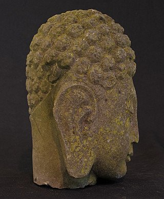 Old granite Buddha head