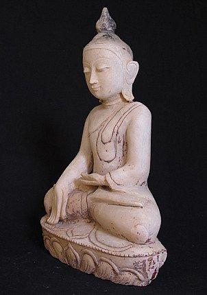 Old marble Buddha