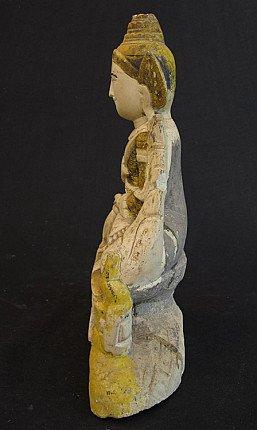 Antique limestone Buddha
